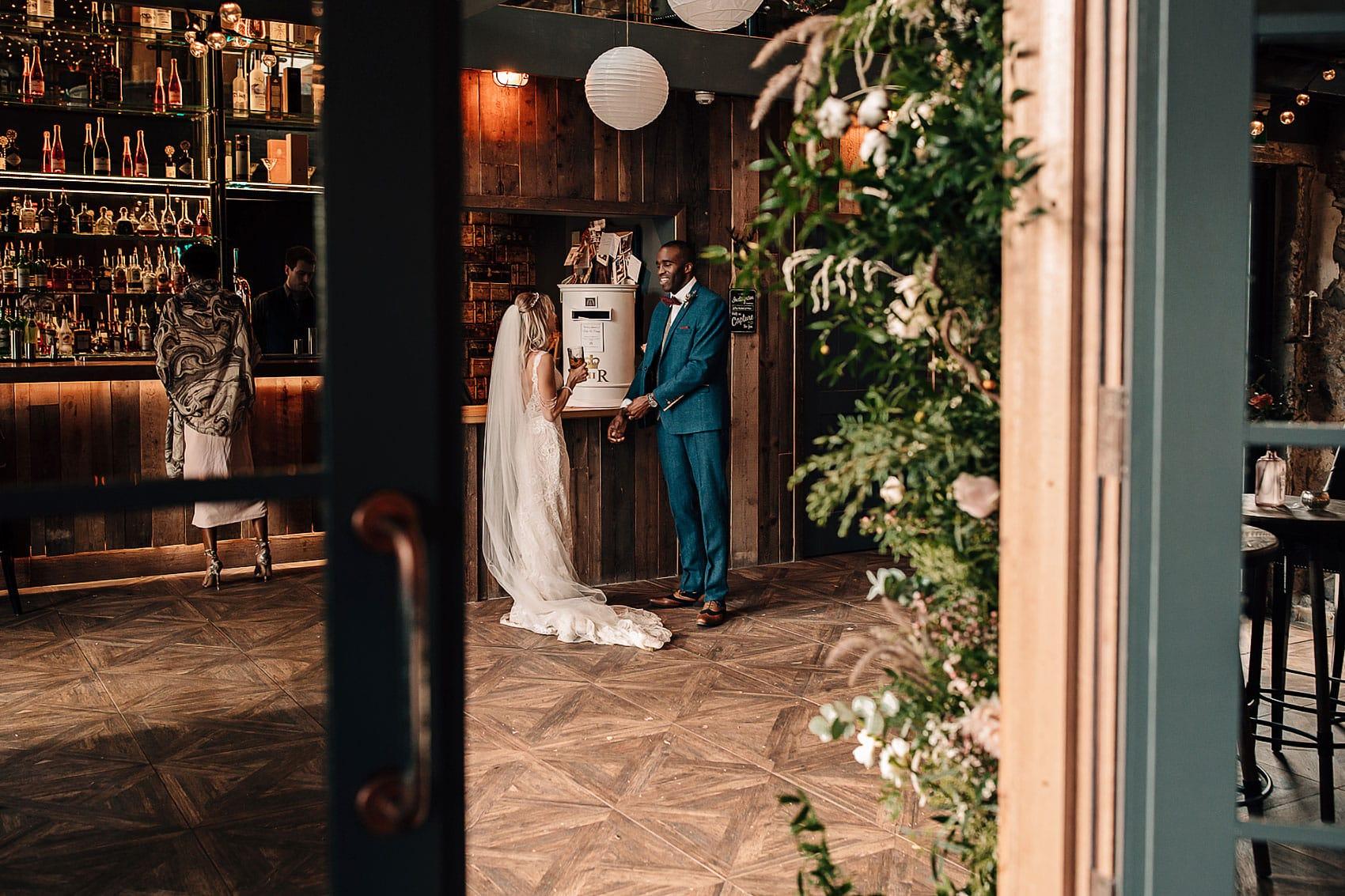 Yorkshire wedding photography wooden barn foliage decor